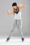 Female modern dancer posing on grey. Background royalty free stock photos