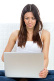 Female with modern laptop typing on keyboard Stock Images