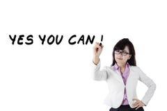 Female motivator writes advice words 2 Stock Image