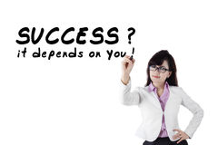 Female motivator writes advice words 1 Stock Image