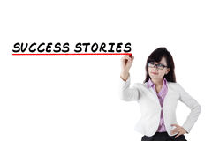 Female motivator writes success stories Stock Photo