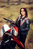 Female Motocross Racer Next to Her Motorcycle Royalty Free Stock Photo