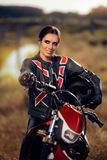 Female Motocross Racer Next to Her Motorcycle Royalty Free Stock Photos