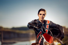 Female Motocross Racer Next to Her Motorcycle. Portrait of a cool sports woman in off road adventure Stock Photos