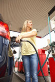 Female Motorist Filling Car With Petrol Stock Photos