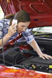 Female Motorist Phoning For Help After Breakdown Stock Photos
