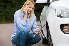 Female Motorist Phoning For Help After Breakdown Stock Photography