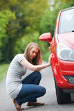 Female Motorist With Puncture On Country Road Stock Images