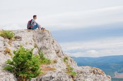 Female on a mountain Stock Images
