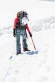 Female mountaineer ascending a glacier. Royalty Free Stock Photos