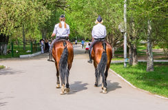 Female mounted police on horse back in the city Park Stock Image