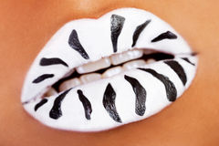 Female mouth closeup. White lipstick with black stripes. Royalty Free Stock Images