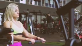 The girl is at the gym. Female muscle bodybuilder exercise in the gym stock footage