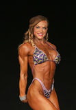 Female Muscle Power. Hardbody Ashley Piersante displays powerful muscles as she earns second place in the Womens Physique Open C Class of the 2015 NPC Universe Stock Photo