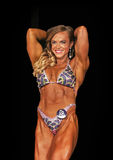Female Muscle Power. Hardbody Ashley Piersante displays powerful muscles as she earns second place in the Womens Physique Open C Class of the 2015 NPC Universe Stock Photography