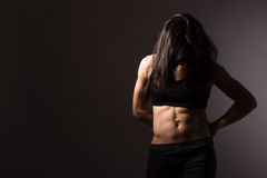 Female muscular body stock photography