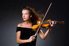 The female musical player against the dark Stock Photography