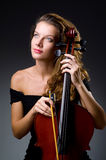 Female musical player against dark background Stock Photo