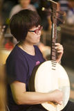 Female musician banjo accompaniment Royalty Free Stock Photography