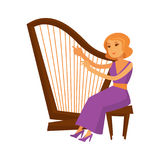 Female musician in dress sitting and playing harp instrument Stock Image