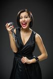Female musician handing microphone Stock Image