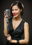 Female musician keeping microphone Stock Images