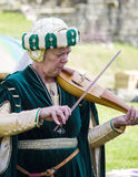 Female musician. Medieval Display. Warkworth, Northumberland. England. UK. Stock Photos