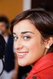 Female Musician Smiling In Recording Studio Stock Photos