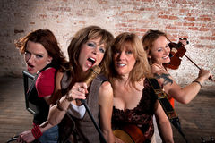 Female Musicians. Stylish all girl pop or country band Royalty Free Stock Photo