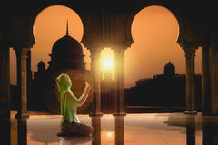 Female muslim praying Stock Images