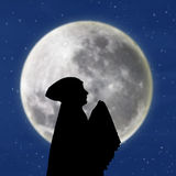 Female muslim praying under blue moon Stock Photos