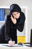 Female muslim at work Stock Photo