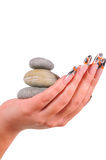 Female nails with pebbles Stock Image