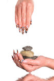 Female nails with pebbles Royalty Free Stock Photo