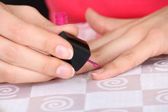 Female nails with pink manicure Stock Photo