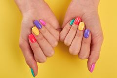 Female nails varnished in different colors. Stock Photo