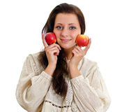 Female in national costume with two apples. Stock Image