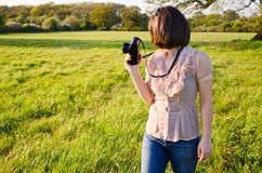Female nature photographer. A beautiful young woman out in nature taking photos Stock Images