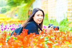 Female Nature Photographer taking pictures outdoors in flower ga Royalty Free Stock Photo