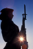 Female Navy Drill Team Member. This stock photo depicts a female member wearing the red beret of the Navy Flying Rifle Drill Team while standing motionless at Stock Photography