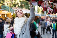 Female near counter with xmas gifts Royalty Free Stock Image