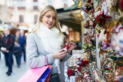 Female near counter with xmas gifts Stock Images