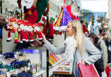 Female near counter with xmas gifts Royalty Free Stock Images