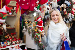 Female near counter with xmas gifts Stock Photos