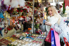 Female near counter with xmas gifts. Portrait of 25s female customer  near counter with Christmas gifts Stock Photos