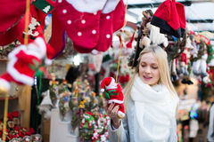 Female near counter with xmas gifts Royalty Free Stock Photos
