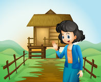 A female near the native farmhouse Royalty Free Stock Images