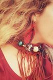 Female neck with brown leather boho necklace and ear with red feathers earrings, handmade jewelry Royalty Free Stock Images