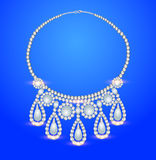 Female necklace with pearls on a blue background Royalty Free Stock Photos