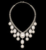 Female necklace wedding with pearls on a black bac Stock Photos